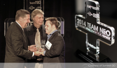Fostering Entrepreneurship Summit DD Microenterprise Program Advisor Gary Peters, and local entrepreneur Todd, accept the Fostering Entrepreneurship award at the NEO Awards event this month. Todd is a specialty greeting card business owner participating in the Microenterprise program.