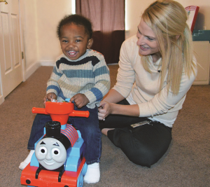 Improving motor skills in the home's living room with a CCBDD Physical Therapist.  Photo courtesy, CCBDD.