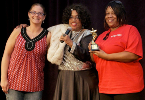 "Left: (L.to R): Donna Lawson, Fatica Ayers, Valencia McAfee.  Donna and Valencia represent Resident Home Association of Greater Dayton.  They made a video entitled ""DS Diva"" which showed a DSP receiving costume parts as she gained trust and built a relationship with the person she supports. Donna and Valencia were presented a Film Star award by Ohio DD Council's inimitable Ms. Ayers."