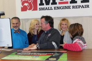 M&A Small Engine Repair owner Michael Richards (center) updates his employment support team about business at the shop, located in downtown Hillsboro. (L. to R.) Kraig Walker and Casey Fraley, Highland County Board of DD; Erin Shaffer, Opportunities for Ohioans with Disabilities; and Michael's wife and business partner, April.