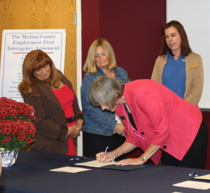 Melanie Kasten-Krause, executive director of the Society for Handicapped Citizens of Medina County (sic), signs the Employment First Interagency Agreement for Transition of Students with Disabilities into the Workforce earlier this month at the Medina County Board of DD. (Photo courtesy, Medina County Gazette)