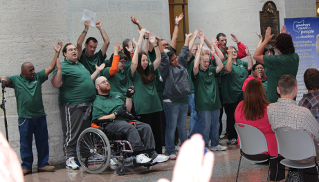 """The TAC choir, representing Clark County area developmental disabilities services organizations, energized the crowd at the Governor's Council on People with Disabilities annual meeting this month (see Employment article, this issue) with several musical selections, including the ever-popular 'Hang on Sloopy' -- punctuated by several enthusiastic choruses of """"O-H-I-O!"""""""