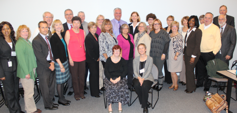 A representative group of SPLG members gathered for a group photo during a break in the benchmarking process. The final meeting was November 4, wrapping up twelve months of discussions and planning.