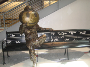 Brutus Buckeye looks rather relaxed and pleased with himself, following outcome of the December 6 football game against the Wisconsin Badgers. Brutus is lounging permanently on a bench in The Ohio State University Student Union on Main Campus.