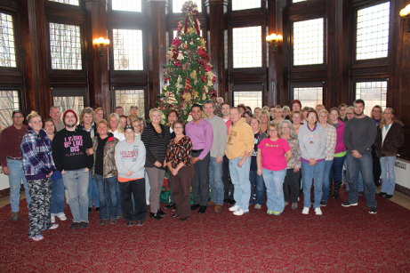 """Participants from the first of three Trauma-Informed Care training sessions at MVDC gathered around the Christmas tree in the Administration Building's Great Room. Superintendent Dana Mattison noted that it was important for everyone at every level of staffing to be involved in the training. She said, """"Everyone – from our maintenance workers, to our front desk, to our direct care staff – everyone needs to learn about this, because it is a system-wide cultural shift that will help us all to better understand and work with each other, and with the people we serve."""""""