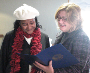 """Leola Howe (left) at her retirement celebration with Sunshine Communities President and CEO Elizabeth Holland, who presented Leola a proclamation from Governor John Kasich and DODD Director John Martin. Miss Lee was touched that so many people wanted to recognize her for her dedication to the field. She said, """"I never thought of this as a job. The people here are my friends. I feel like this is what I was meant to do -- give them loving care."""""""