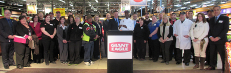 "At the Giant Eagle ceremony, OOD Director Kevin Miller (at left of podium) joins many Giant Eagle employees and OOD support staff in celebrating the Champion of Opportunity Award. Accepting the award, Market District and GetGo official Jeremy Shapira said, ""For more than 30 years, Giant Eagle has provided career opportunities for people with disabilities.  Like all of us at Giant Eagle, these Team Members help create an inclusive and diverse working environment, and are relied upon to meet the needs of our customers."""