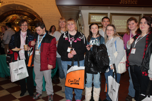 """Hocking County Shows a Can Do Attitude Melaine Barlow and son Ben (at left), along with an enthusiastic group from Hocking County, get ready to head over to the DD Awareness and Advocacy program in the Ohio Statehouse Atrium. Ben, CEO of Ben's Bucket of Wings, was handing out business cards left and right for the fledgling Logan County micro-business. """"We're here for the first time.  We're going to learn a lot today."""""""