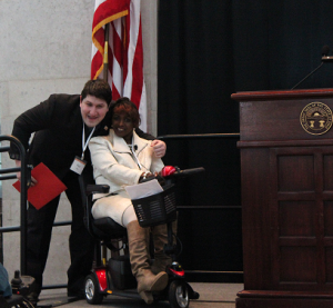 """Paul Day and Shari Cooper Keep the Program Moving President of People First of Ohio Paul Day, and Shari Cooper, self advocate and master of ceremonies for the program, are fired up about the potential of absolutely everyone in the room.   """"What do you want to do?  What do you really want to do?  Well, you can do it!"""""""