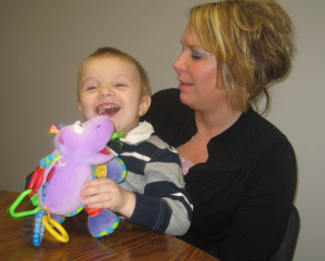 "The Mercer County Board of DD got involved in the PLAY Project several years ago. This photo from Pipeline Quarterly, Winter 2010-2011, shows Emmett and his Mom, Tennille. She said that Emmett's interactions with toys, and with people, ""just exploded"" while learning and using the PLAY techniques."