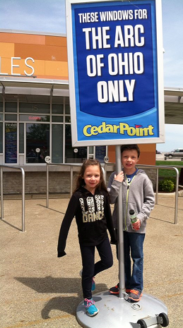 Addison and Jackson show the way! Welcoming the thousands who attended from the many chapters of The Arc of Ohio, Addison (left) and Jackson share the showmanship of their grandpa – The Arc of Ohio Executive Director Gary Tonks!  He noted that in addition to the thousands of Ohioans who attended The Arc Day at Cedar Point on May 20, The Arc/ Mercer flew in from a sister chapter in Trenton, New Jersey!