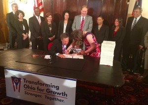 Governor Kasich signing the budget